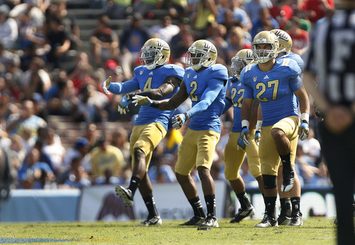 Scott Sommerdorf  |  The Salt Lake Tribune              At one point in the third quarter, the UCLA defense including safety Stan McKay (4), DB Brandon Sermons (2), and the rest of the defense did a little dance while the Utes offense was coming out of a time out. UCLA defeated Utah 21-14 in Pasadena, Saturday, October 13, 2012.