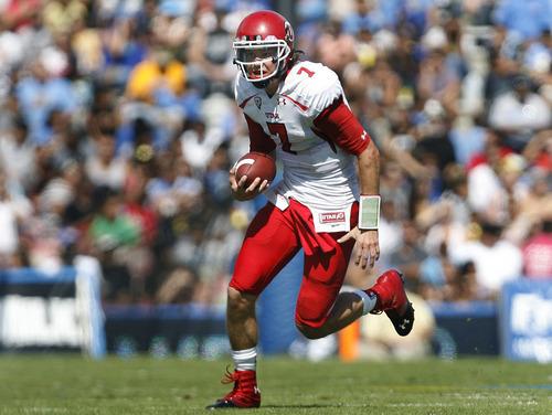 Scott Sommerdorf  |  The Salt Lake Tribune              Utah Utes quarterback Travis Wilson (7) runs during first half play. UCLA led Utah 14-7 at the half. Utah plays UCLA in Pasadena, Saturday, October 13, 2012.