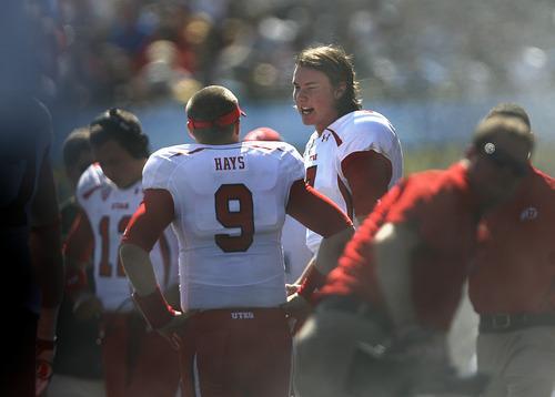 Scott Sommerdorf  |  The Salt Lake Tribune              Utah Utes quarterback Jon Hays (9) speaks with Utah Utes quarterback Travis Wilson (7) after Wilson threw his first interceptionof the day. UCLA led Utah 14-7 at the half. Utah plays UCLA in Pasadena, Saturday, October 13, 2012.