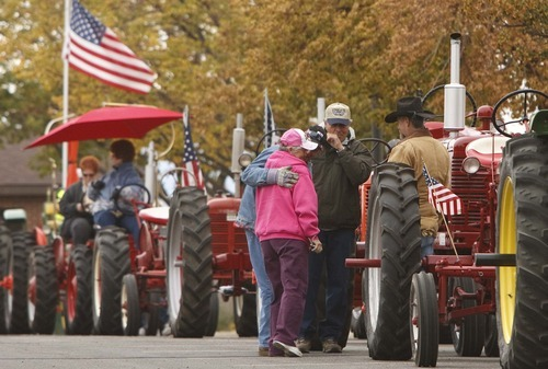 Leah Hogsten     The Salt Lake Tribune Members of the Great Basin Antique Machinery Branch 95 parade their antique tractors throughout West Haven on their annual fun run Saturday, October 13, 2012 in West Haven.