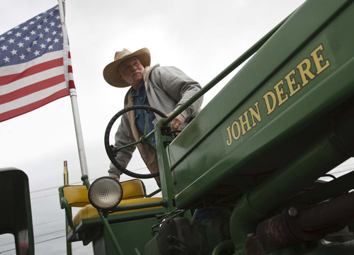 Leah Hogsten     The Salt Lake Tribune Robert Brimhall, who grew up working on the family farm in Weber County and now restores antique tractors in Washington County, takes part in the tractor parade on Saturday.