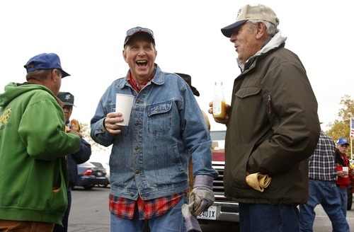 Leah Hogsten     The Salt Lake Tribune Jay Riggs, left, and Ben Meier share a laugh during a social break and snack during the ride Saturday in West Haven. Members of the Great Basin Antique Machinery Branch 95 paraded their antique tractors throughout town.