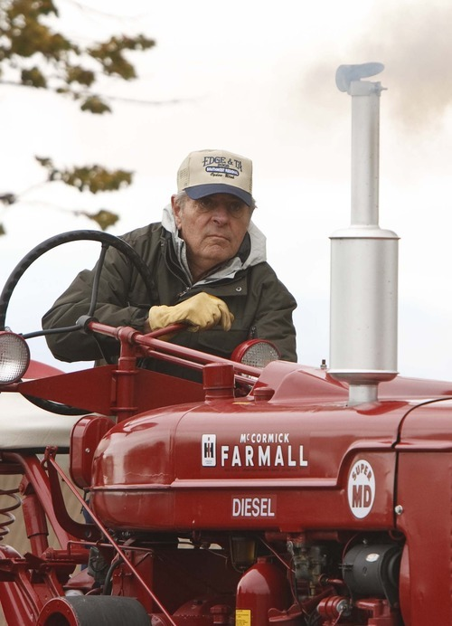 Leah Hogsten     The Salt Lake Tribune Ben Meier clears the carbon out of the diesel engine of his International Harvester on Saturday. Members of the Great Basin Antique Machinery Branch 95 paraded their antique tractors throughout West Haven on their annual fun run.