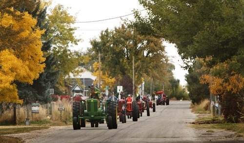 Leah Hogsten     The Salt Lake Tribune Jeffery East, of Plain City, leads the group as members of the Great Basin Antique Machinery Branch 95 parade their antique tractors throughout West Haven on their annual fun run Saturday, October 13, 2012 in West Haven.