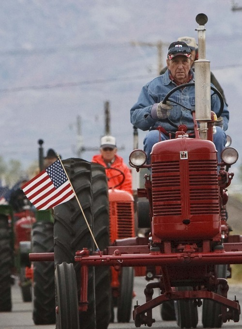 Leah Hogsten     The Salt Lake Tribune Jay Riggs, of West Haven, drives an International Harvester as members of the Great Basin Antique Machinery Branch 95 parade their antique tractors throughout West Haven on their annual fun run Saturday, October 13, 2012 in West Haven.
