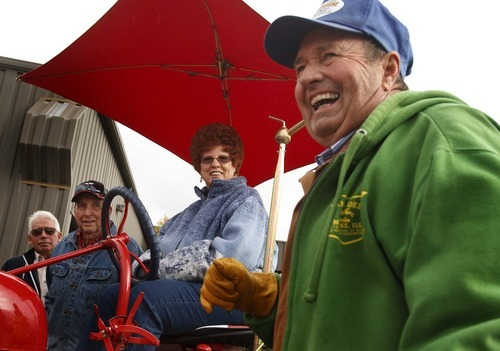 Leah Hogsten     The Salt Lake Tribune Organizer Jeffery East, right, shares a laugh with fellow members of the Great Basin Antique Machinery Branch 95 before the two-hour tour Saturday in West Haven. Members of the branch paraded their antique tractors throughout West Haven on their annual fun run.
