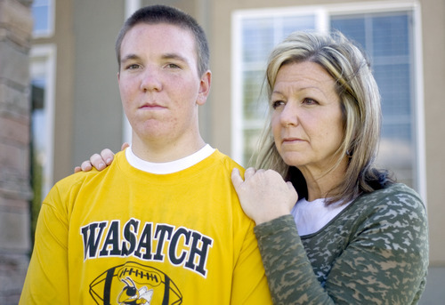 Kim Raff | The Salt Lake Tribune Koen Hyde sustained a severe concussion during wrestling season last spring that has kept him on the sidelines this football season.  After sustaining the concussion he didn't recognize his mother, (right) Rebecca Hyde.  They are pictured outside their home in Heber on Sept. 7, 2012.