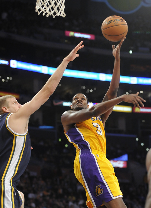 Los Angeles Lakers forward Devin Ebanks (3) shoots over Utah Jazz center Brian Butch, left, in the second half of an NBA preseason basketball game, Saturday, Oct. 13, 2012, in Los Angeles. The Jazz won 99-86. (AP Photo/Gus Ruelas)