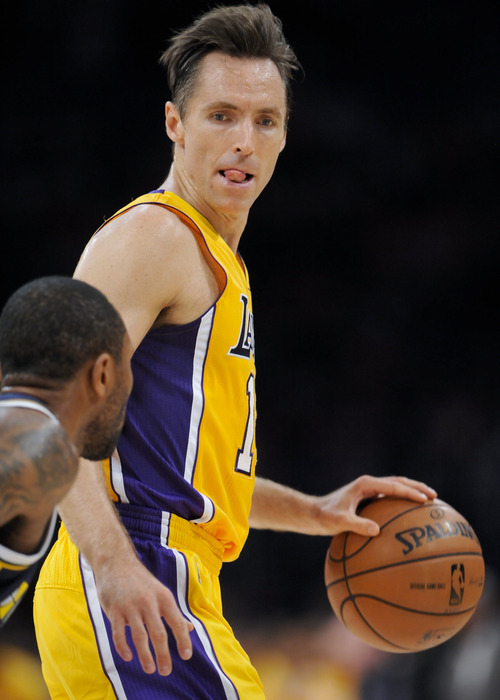 Los Angeles Lakers guard Steve Nash, right, looks at Utah Jazz guard Mo Williams, left, as he brings the ball up court  in the first half of an NBA preseason basketball game, Saturday, Oct. 13, 2012, in Los Angeles. The Jazz won 99-86. (AP Photo/Gus Ruelas)