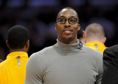 Los Angeles Lakers center Dwight Howard looks on in the first half of an NBA preseason basketball game against the Utah Jazz, Saturday, Oct. 13, 2012, in Los Angeles. (AP Photo/Gus Ruelas)