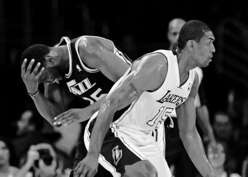 Utah Jazz center Al Jefferson (25) reacts after colliding with Los Angeles Lakers forward Metta World Peace (15) in the first half of an NBA preseason basketball game, Saturday, Oct. 13, 2012, in Los Angeles. (AP Photo/Gus Ruelas)