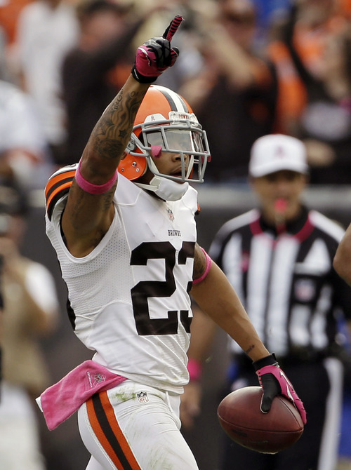 Cleveland Browns cornerback Joe Haden celebrates an interception against the Cincinnati Bengals in the third quarter of an NFL football game on Sunday, Oct. 14, 2012, in Cleveland. (AP Photo/Mark Duncan)