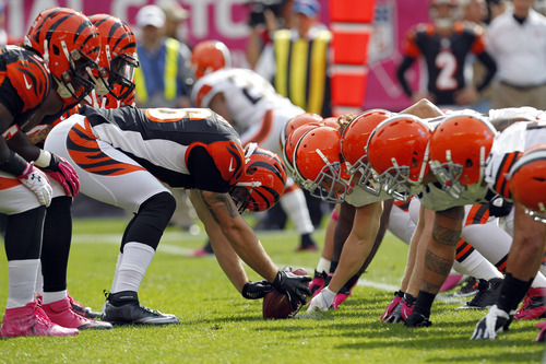 Cincinnati Bengals long snapper Clark Harris, center, prepares to snap on a punt against the Cleveland Browns, right, in the first quarter of an NFL football game Sunday, Oct. 14, 2012, in Cleveland. (AP Photo/Tony Dejak)