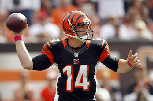 Cincinnati Bengals quarterback Andy Dalton passes against the Cleveland Browns in the first quarter of an NFL football game Sunday, Oct. 14, 2012, in Cleveland. (AP Photo/Tony Dejak)