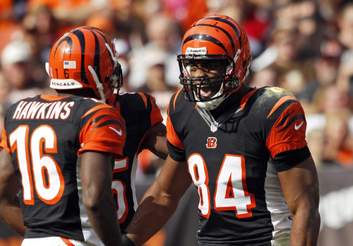 Cincinnati Bengals tight end Jermaine Gresham (84) celebrates his 55-yard touchdown catch with Andrew Hawkins (16) in the first quarter of an NFL football game against the Cleveland Browns Sunday, Oct. 14, 2012, in Cleveland. (AP Photo/Scott R. Galvin)