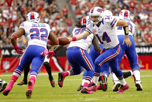 Buffalo Bills quarterback Ryan Fitzpatrick (14) hands off to Fred Jackson (22) during the first half on an NFL football game against the Arizona Cardinals, Sunday, Oct. 14, 2012, in Glendale, Ariz.  (AP Photo/Matt York)