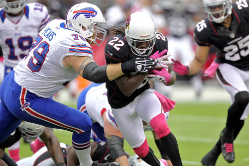 Arizona Cardinals cornerback William Gay (22) is tackled by Buffalo Bills tackle Erik Pears (79) during the first half on an NFL football game, Sunday, Oct. 14, 2012, in Glendale, Ariz.  (AP Photo/Paul Connors)