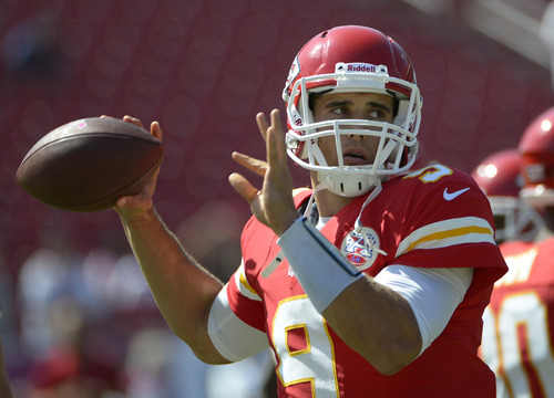Kansas City Chiefs quarterback Brady Quinn (9) throws during warmups prior to an NFL football game against the Tampa Bay Buccaneers in Tampa, Fla., Sunday, Oct. 14, 2012.(AP Photo/Phelan M. Ebenhack)