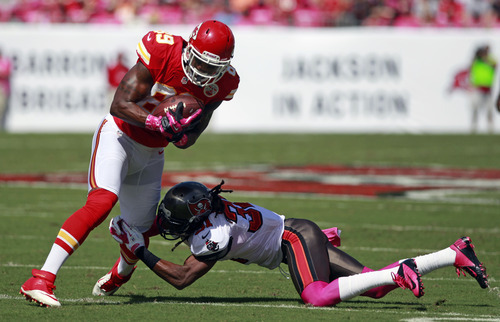 Kansas City Chiefs wide receiver Jon Baldwin, left, is tackled by Tampa Bay Buccaneers cornerback E.J. Biggers after a reception during the first half of an NFL football game, Sunday, Oct. 14, 2012, in Tampa, Fla. (AP Photo/John Raoux)