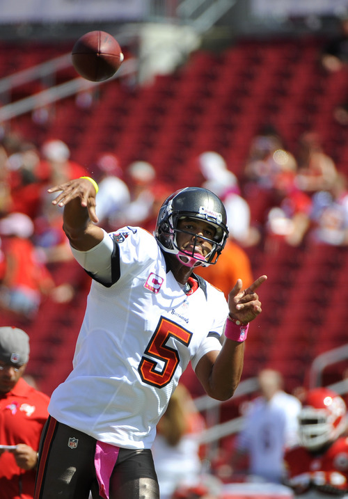 Tampa Bay Buccaneers quarterback Josh Freeman warms up before the start of an NFL football game against the Kansas City Chiefs Sunday, Oct. 14, 2012, in Tampa, Fla. (AP Photo/Brian Blanco)