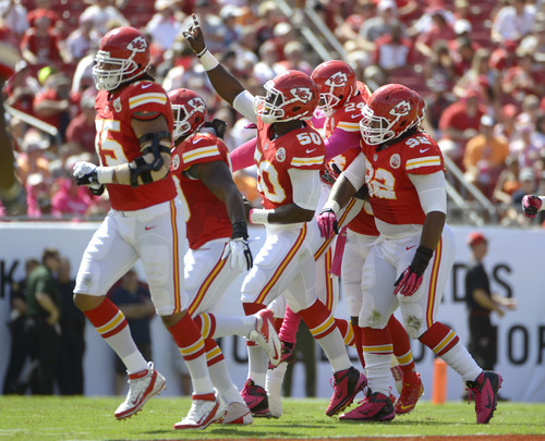 Kansas City Chiefs outside linebacker Justin Houston (50) celebrates with teammates including Brandon Flowers (24) and Dontari Poe (92) after intercepting a pass against the Tampa Bay Buccaneers during the first half of an NFL football game, Sunday, Oct. 14, 2012, in Tampa, Fla. (AP Photo/Phelan M. Ebenhack)