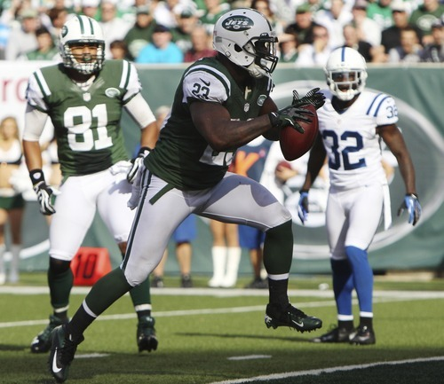 New York Jets running back Shonn Greene (23) rushes for a touchdown as teammate Dustin Keller (81) and Indianapolis Colts cornerback Cassius Vaughn (32) watch him during the second half of an NFL football game Sunday, Oct. 14, 2012 in East Rutherford, N.J. The Jets won the game 35-9. (AP Photo/Seth Wenig)