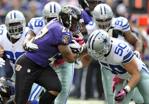Baltimore Ravens running back Ray Rice (27) rushes the ball in the first half of an NFL football game against the Dallas Cowboys in Baltimore, Sunday, Oct. 14, 2012. (AP Photo/Gail Burton)