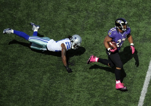 Baltimore Ravens running back Ray Rice, right, rushes past Dallas Cowboys cornerback Mike Jenkins in the first half of an NFL football game in Baltimore, Sunday, Oct. 14, 2012. (AP Photo/Nick Wass)