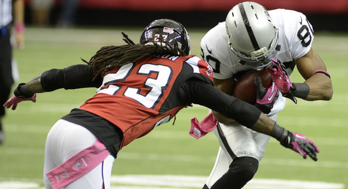 Oakland Raiders wide receiver Rod Streater (80) makes the catch against Atlanta Falcons cornerback Dunta Robinson (23) during the first half of an NFL football game, Sunday, Oct. 14, 2012, in Atlanta. (AP Photo/Billy Weeks)