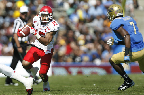 Scott Sommerdorf  |  The Salt Lake Tribune              Utah Utes running back John White (15) runs against UCLA during second half play. UCLA defeated Utah 21-14 in Pasadena, Saturday, October 13, 2012.