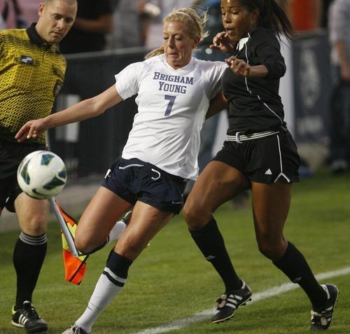 Paul Fraughton | Salt Lake Tribune BYU's Carlee Payne Holmoe kicks the ball away from UVU's Courtney Wilson. BYU played Utah Valley University at BYU's field.   Thursday, September 27, 2012