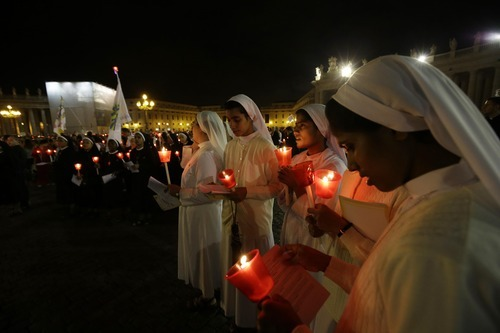 Nuns participate in a candlelight procession to mark the 50th anniversary of the Second Vatican Council, the church meetings that modernized the Catholic Church but whose true results are still hotly debated, in St. Peter's square, at the Vatican, Thursday, Oct. 11, 2012. Pope Benedict XVI denounced the