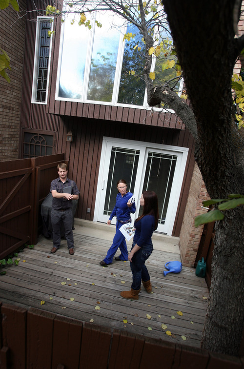 Steve Griffin | The Salt Lake Tribune   Adam Kirkham, of Kirkham Real Estate, left, shows a town home to Gay Meyers, center, and her daughter Madison Meyers in Salt Lake City, Utah Monday October 15, 2012.