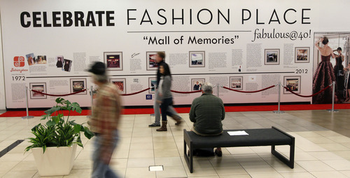 Al Hartmann  |  The Salt Lake Tribune Shoppers pass by a