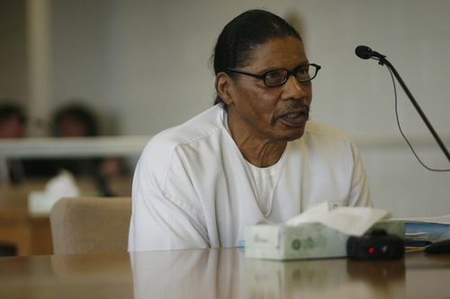 Tribune file photo Elroy Tillman speaks during a parole hearing at the Utah State Prison in 2009. Tillman was convicted in 1982 of killing Mark Schoenfeld with an ax.