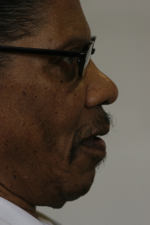 Elroy Tillman listens during a parole hearing at the Utah State Prison in 2009. Tillman was convicted in 1982 of killing Mark Schoenfeld with an ax.