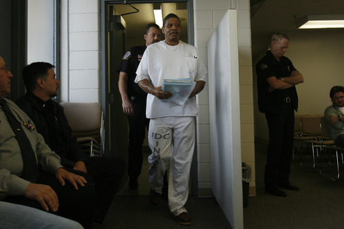 Tribune file photo Elroy Tillman arrives for a parole hearing at the Utah State Prison in 2009. Tillman was convicted in 1982 of killing Mark Schoenfeld with an ax.
