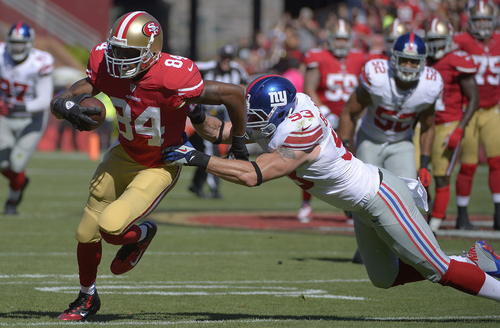 San Francisco 49ers wide receiver Randy Moss (84) runs past New York Giants middle linebacker Chase Blackburn (93) during the first quarter of an NFL football game in San Francisco, Sunday, Oct. 14, 2012. (AP Photo/Mark J. Terrill)