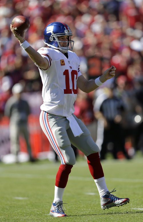 New York Giants quarterback Eli Manning (10) passes against the San Francisco 49ers during the first quarter of an NFL football game in San Francisco, Sunday, Oct. 14, 2012. (AP Photo/Marcio Jose Sanchez)