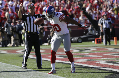 New York Giants wide receiver Victor Cruz (80) celebrates after catching a 6-yard touchdown pass from quarterback Eli Manning against the San Francisco 49ers during the second quarter of an NFL football game in San Francisco, Sunday, Oct. 14, 2012. (AP Photo/Marcio Jose Sanchez)