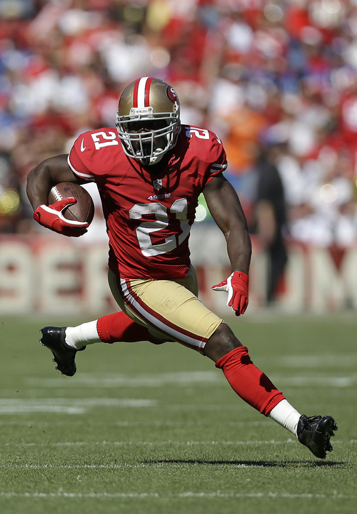 San Francisco 49ers running back Frank Gore (21) runs against the New York Giants during the first quarter of an NFL football game in San Francisco, Sunday, Oct. 14, 2012. (AP Photo/Marcio Jose Sanchez)