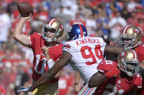 San Francisco 49ers quarterback Alex Smith (11) passes as New York Giants outside linebacker Mathias Kiwanuka (94) applies pressure during the first quarter of an NFL football game in San Francisco, Sunday, Oct. 14, 2012. (AP Photo/Mark J. Terrill)