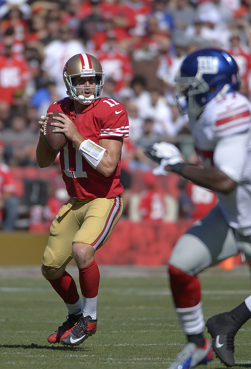 San Francisco 49ers quarterback Alex Smith (11) against the New York Giants during the first half of an NFL football game in San Francisco, Sunday, Oct. 14, 2012. (AP Photo/Mark J. Terrill)