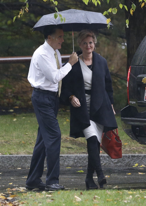 Republican presidential candidate and former Massachusetts Gov. Mitt Romney walks with wife Ann at the Church of Jesus Christ of Latter-day Saints in Belmont, Mass., Sunday, Oct. 14, 2012. (AP Photo/Charles Dharapak)