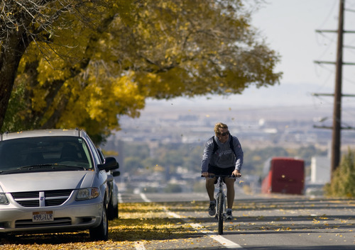 Kim Raff  |  The Salt Lake Tribune A bike rider travels on east Sunnyside Avenue in Salt Lake City on Sunday, October 14, 2012. In January, Mayor Ralph Becker, as part of his