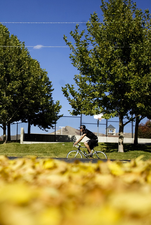 Kim Raff |  The Salt Lake Tribune A bike rider travels west on Sunnyside Avenue in Salt Lake City on Sunday, October 14, 2012. In January, Mayor Ralph Becker, as part of his
