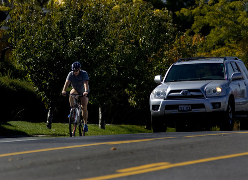Kim Raff  |  The Salt Lake Tribune A bike rider travels east on Sunnyside Avenue in Salt Lake City on Sunday, October 14, 2012. In January, Mayor Ralph Becker, as part of his