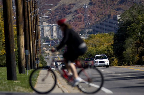Kim Raff  |  The Salt Lake Tribune A bike rider travels across Sunnyside Avenue in Salt Lake City on Sunday,  October 14, 2012. In January, Mayor Ralph Becker, as part of his