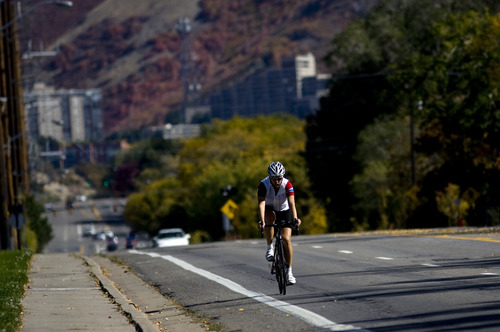 Kim Raff  |  The Salt Lake Tribune A bike rider travels on Sunnyside Avenue toward Guardsman Way in Salt Lake City on Sunday, October 14, 2012. In January, Mayor Ralph Becker, as part of his