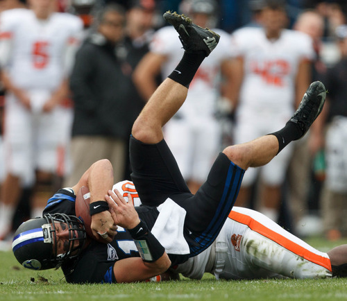Trent Nelson  |  The Salt Lake Tribune BYU quarterback Riley Nelson is brought down by Oregon State's Michael Doctor in a game Saturday, Oct. 13, 2012 in Provo.